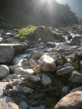 Sun on river Val Verzsca.