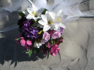 A wedding bouquet on the sand. Folly Beach, South Carolina
