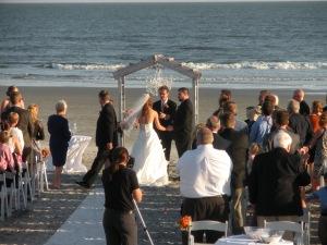 Afternoon beach wedding in Charleston South Carolina area. Photo by Debra Moffitt