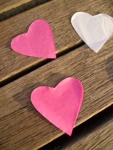 Paper wedding hearts on dock. Photo by Debra Moffitt