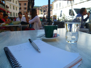 Photo by Debra Moffitt. Writing at a French Cafe.