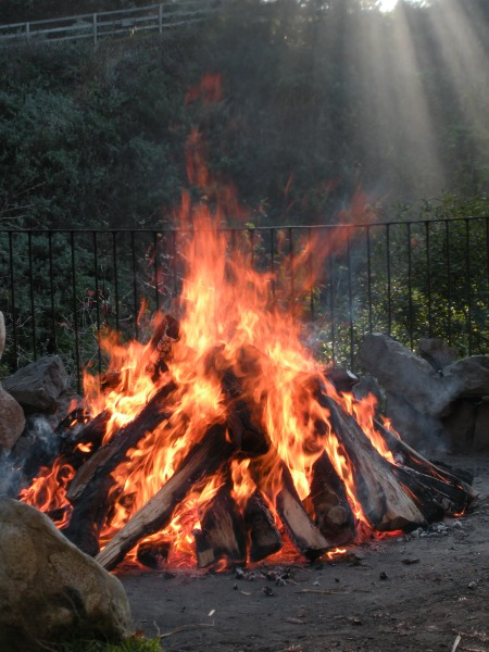 Bonfire to heat stones for a sweat lodge at Esalen Institute. Photo by Debra Moffitt.  For me entering the sweat lodge felt scary -- and I didn't stay inside long!