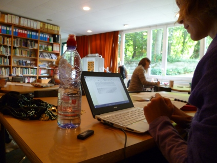 Writers Cafe Nathalie with computer and Valais water nice one sep 2015