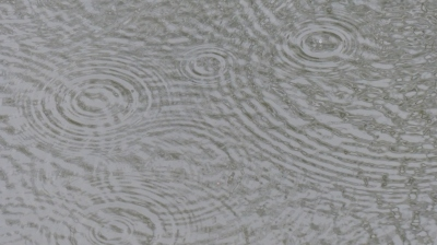 Rain drops on water