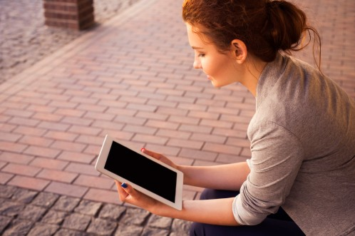 warm tones woman with tablet.jpg
